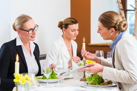 business dinner: Businesswomen meeting at business dinner or lunch in Restaurant