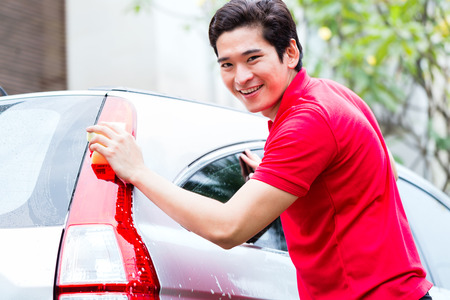asian trees: Asian man cleaning and washing car with sponge