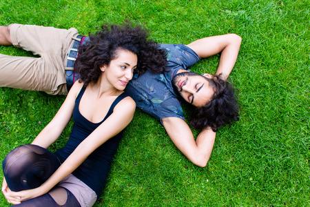 huddling: Couple, Latin man and woman, girlfriend and boyfriend, on meadow sleeping in summer