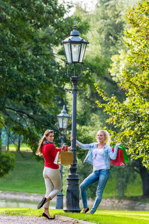 city light: Women with shopping bags on city light lantern