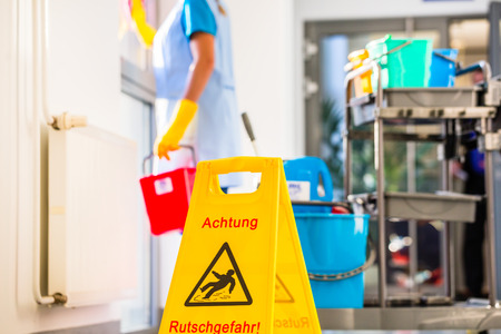 business: Warning sign on floor in cleaning operation Stock Photo