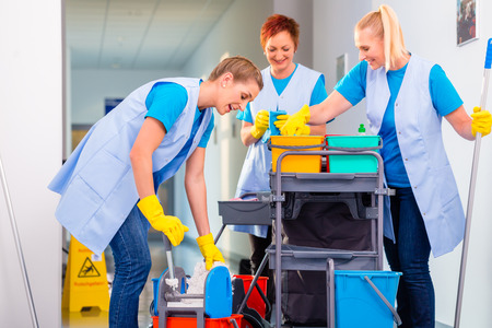 Commercial cleaning brigade working in corridor Stock Photo