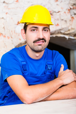 unsatisfied: Unsatisfied construction worker on site grunting