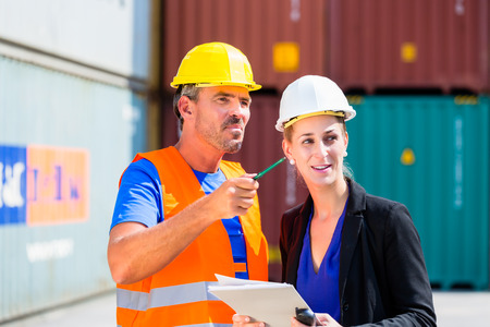freight forwarding: Employees in logistics company shipping containers with clipboard
