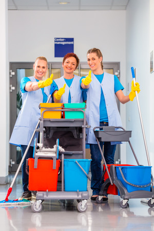 Cleaning service at work, tree women in teamwork Stock Photo