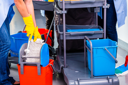charlady: Cleaning ladies mopping floor, close up on hands and tools