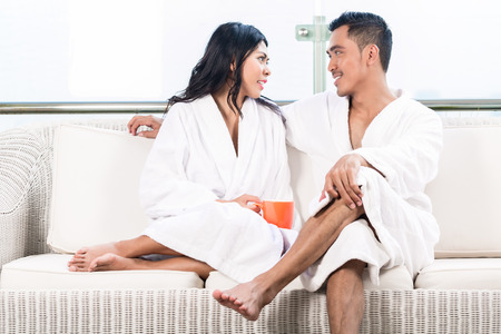 Couple in morning sitting on couch photo