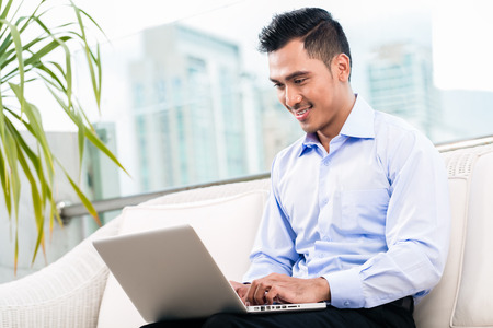 telecommuter: Businessman working with laptop from home being a telecommuter