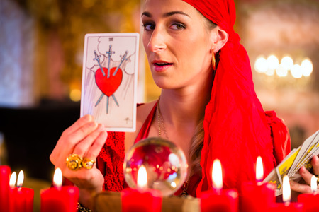 fortuneteller: Fortuneteller with Tarot cards or esoteric Oracle, sees in the future Stock Photo