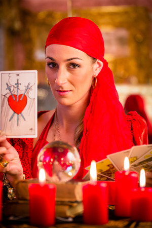 oracle: Fortuneteller with Tarot cards or esoteric Oracle, sees in the future Stock Photo