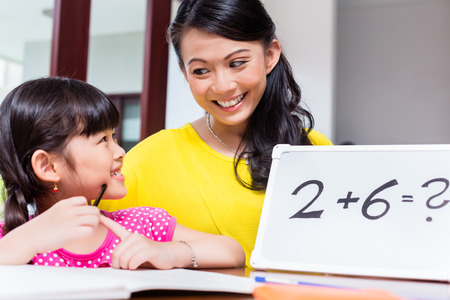 indonesia girl: Chinese mother teaching mathematics to child