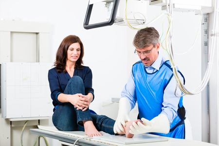 orthopaedist: Orthopedist doctor making x-ray of patient leg in surgery