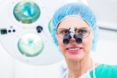 orthopaedist: Orthopedic surgeon with special glasses in operating room Stock Photo