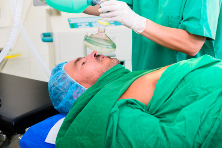 anesthetic: Surgeon in operating room with anesthetic mask