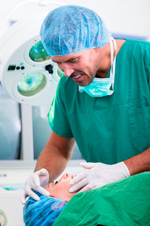 Doctor in operation at patient in operating room Stock Photo