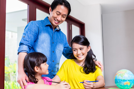 chinese family: Chinese family teaching mathematics to their child