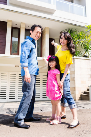 family outside: Chinese Family in front of house in residential area in Asia