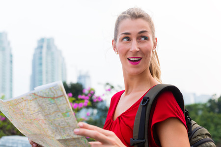 touristic: Woman sightseeing city with touristic map in Jakarta, Indonesia