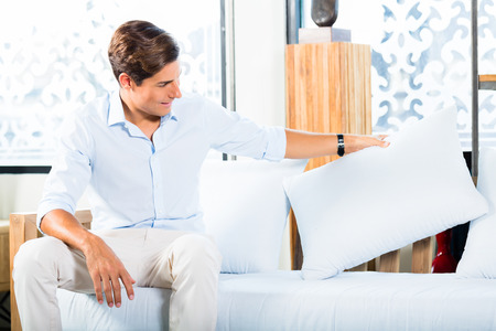 furniture store: Man buying sofa in furniture store showroom Stock Photo