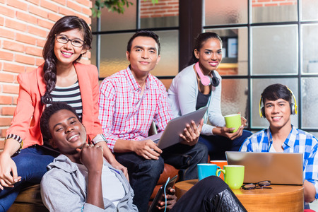 workgroup: Group of diversity college students learning on campus, Indian, black, and Indonesian people Stock Photo