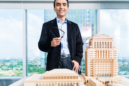 architecture model: Indian architect in office with architecture model Stock Photo