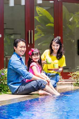 coffee houses: Chinese Family at pool in front of home or house drinking coffee