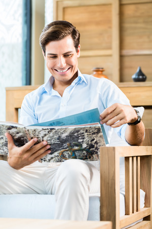 browsing: Man in furniture store browsing catalog Stock Photo