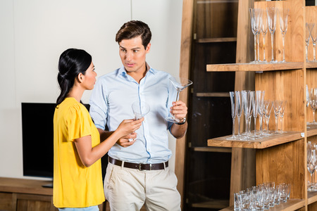 furniture store: Couple in furniture store Stock Photo