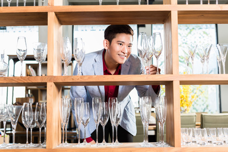 korean man: Korean man buying glasses or household items Stock Photo