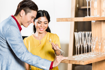 furniture store: Asian couple buying stuff in furniture store Stock Photo