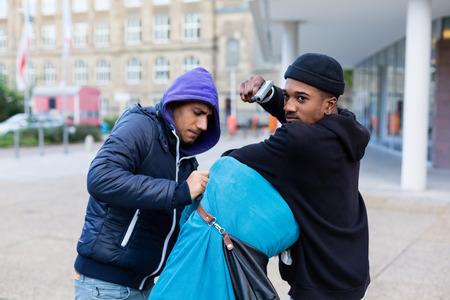 gang: Criminal street gang of robbers taking hostage with gun