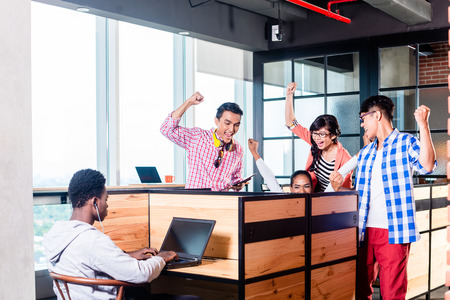 hip: Start-up business people in cubicles working together having success