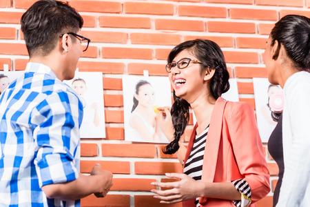 advertising agency: Team in advertising agency choosing pictures of models Stock Photo