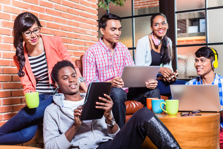 school campus: Group of diversity college students learning on campus, Indian, black, and Indonesian people Stock Photo