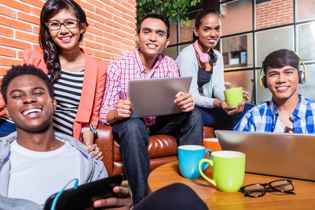 Group of diversity college students learning on campus, Indian, black, and Indonesian people Stock Photo