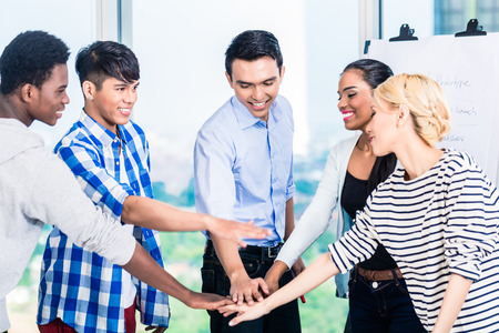 spirit: Tech entrepreneurs with team spirit and motivation Stock Photo