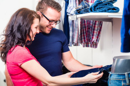 Couple buying blue jeans in shop or store photo