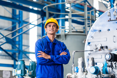 metal worker: Proud Asian worker standing in production factory Stock Photo
