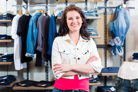 Woman buying clothes in shop photo
