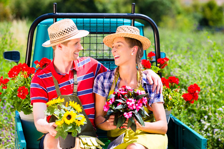 gape: Couple in garden with flowers on gape
