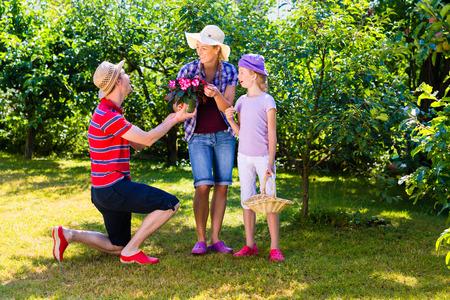 family garden: Family in garden
