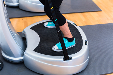 Woman plates in gym doing fitness exercise 스톡 콘텐츠