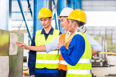 production engineer: Team of workers and engineer  in Factory at production training with laptop