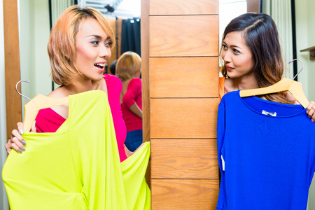 Asian best friends, two girls, shopping in fashion store photo