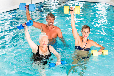 Group of people, mature man, young and senior women, at water gymnastics or aquarobics Reklamní fotografie