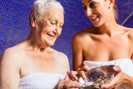 woman in bath: Woman at Rasul bath in wellness spa