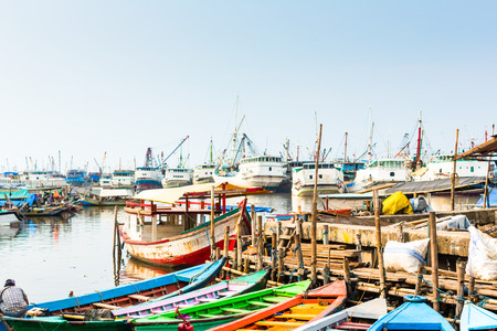 Sunda Kelapa old Harbour  with fishing boats, ship and docks in Jakarta, Indonesia photo