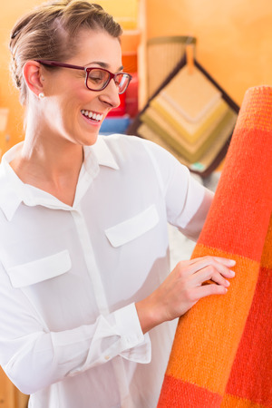 home improvement store: Interior Designer buying rug or carpeting in home improvement store