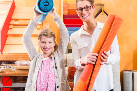 home improvement store: Family Designer buying rug or carpeting in home improvement store
