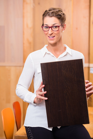 home improvement store: Interior architect choosing parquet wood floor in home improvement store Stock Photo